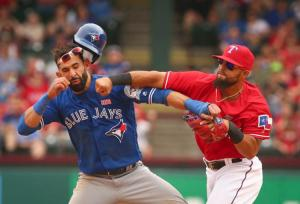 Bautista trying to slide into Odor's DMs...he wasn't having any of that photo-nytimes.com
